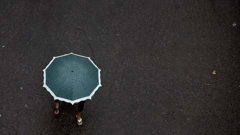 Indian girls share an umbrella and walk on a street in Gauhati, India, Tuesday, May 30, 2017. Several northeastern Indian states experienced heavy rainfall as an effect of tropical cyclone Mora that lashed southern Bangladesh on Tuesday. (AP Photo/ Anupam Nath)