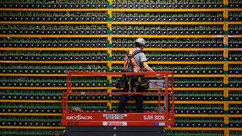 A technician inspects the backside of bitcoin mining at Bitfarms in Saint Hyacinthe, Quebec on March 19, 2018.