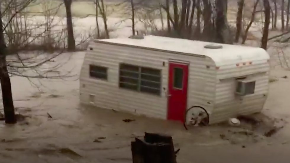 Indiana Floodwaters Carry Away Camper While Owner Cries