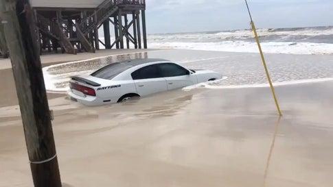 Car Sinks in Sand in Alabama as Tropical Storm Barry Nears Coast
