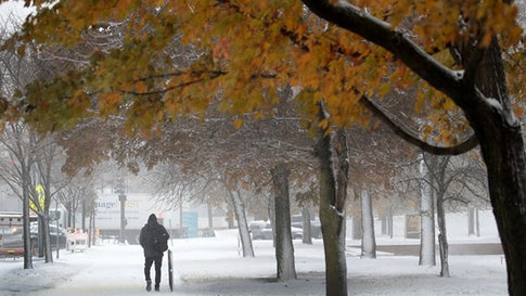 CHICAGO, ILLINOIS - NOVEMBER 11: People navigate snow-covered sidewalks in the Humboldt Park neighborhood on November 11, 2019 in Chicago, Illinois. Forecasters are calling for three to six inches of snow to fall in the Chicago area by mid-day today and temperatures are expected to fall to around ten degrees by tomorrow.  (Photo by Scott Olson/Getty Images)