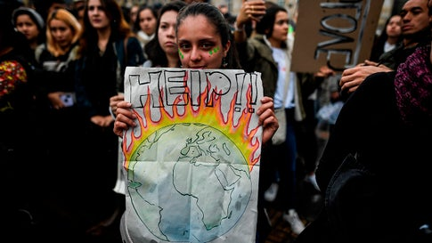 """A woman holds a sign during a protest at Bolivar Square in Bogota, Colombia, on September 20, 2019, as part of the """"Friday for the planet"""" global demonstration against climate change. (Juan Barreto/AFP via Getty Images)"""