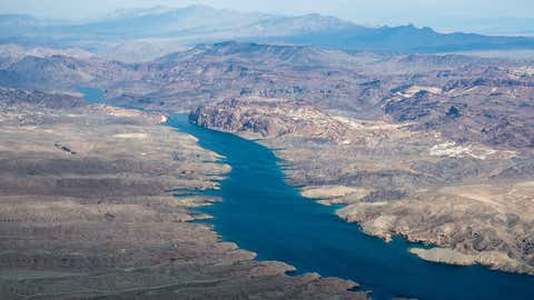 An aerial view of the Colorado River downstream of Lake Mead and upstream of Lake Mohave. The river system serves about 40 million people and 6,300 square miles of farmland from Wyoming to Southern California. (U.S. Bureau of Reclamation)