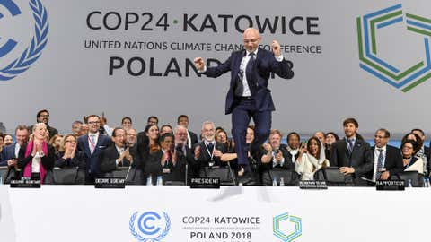 COP24 president Michal Kurtyka jumps at the end of the final session of the COP24 summit on climate change in Katowice, southern Poland, on December 15, 2018. (Photo by Janek SKARZYNSKI / AFP) (Photo credit should read JANEK SKARZYNSKI/AFP/Getty Images)