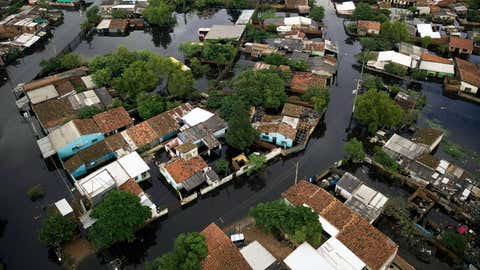 The Santa Ana neighborhood is flooded in Asuncion, Paraguay, Tuesday, May 7, 2019. Officials say they've had to evacuate some 40,000 people due to unusually heavy rains since March. (AP Photo/Jorge Saenz)