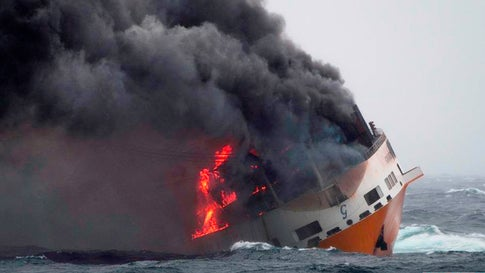This photo provided on Thursday March 14, 2019 by the Marine Nationale, shows the Grimaldi vessel Grande America on fire in the Bay of Biscay, off the west coast of France, Monday March 11, 2019. French authorities are working to contain an oil spill off the Atlantic Coast after the Italian tanker sank following a fire. French and British rescue teams saved all 27 people aboard the Grande America tanker after it sank Tuesday. (Loic Bernardin/Marine Nationale via AP)