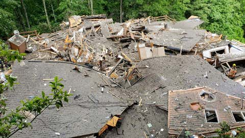 A home in Boone, N.C., collapsed under a landslide on Wednesday, killing two people inside. (Twitter/@boonepolice)