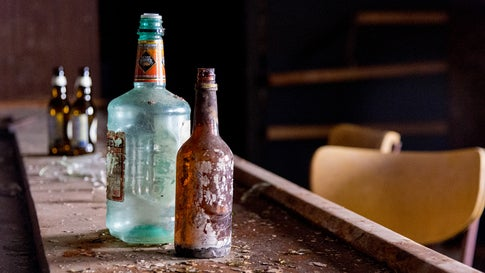 Old alcohol bottles are seen left behind, their labels peeling, in a southern New Jersey bar that has been abandoned.  Photographer Liz Roll travels the U.S. photographing abandoned locations, such as restaurants, bars, rest stops, homes and factories. (Liz Roll)