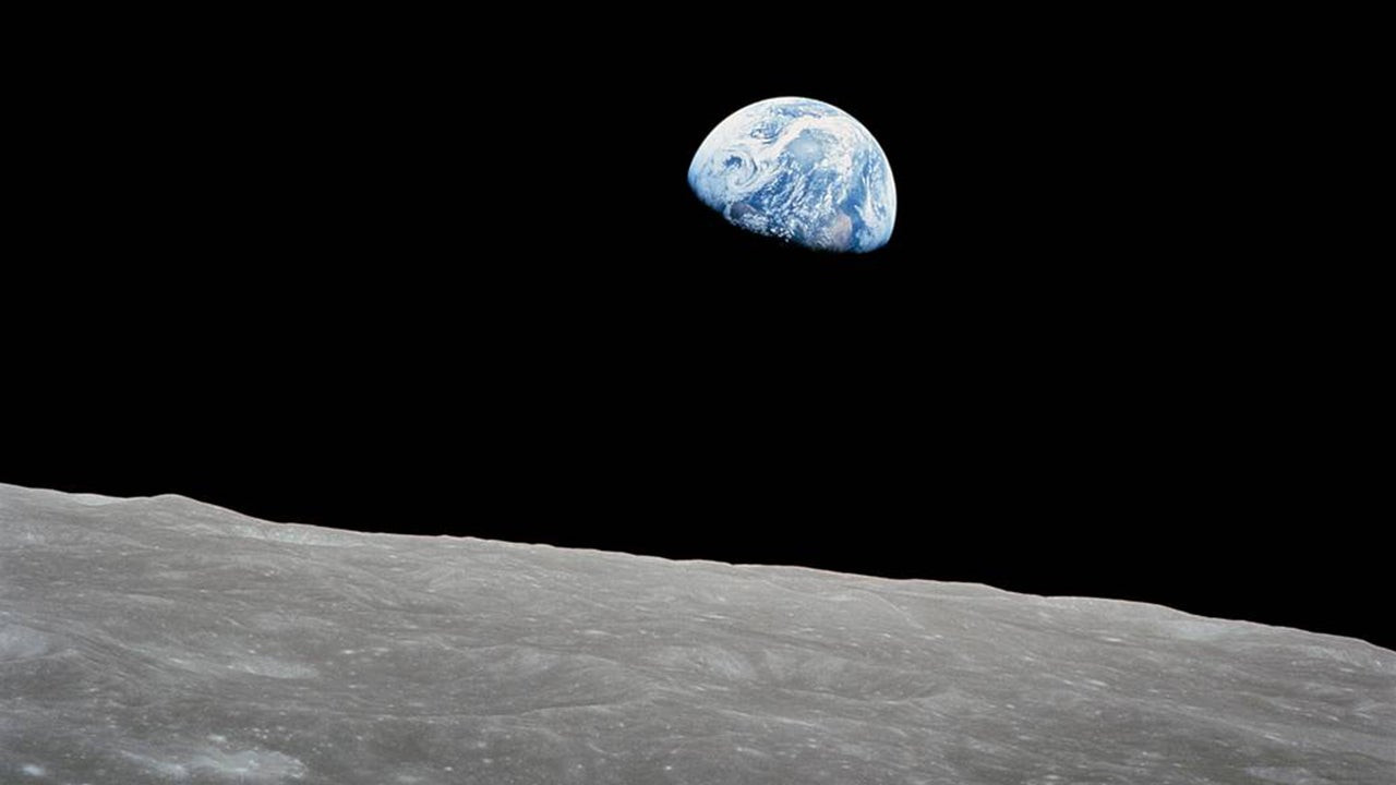 """Earth rises over the lunar horizon in this image that came to be known as """"Earthrise."""" It was made by Apollo 8 astronaut Bill Anders on Christmas Eve in 1968. (Bill Anders/NASA)"""