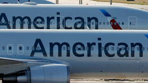 A pair of American Airlines jets are parked on the airport apron at Miami International Airport in Miami on Nov. 6, 2017. (Wilfredo Lee/THE ASSOCIATED PRESS)