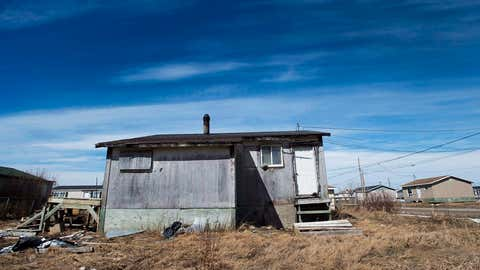 The house is in the northern Ontario First Nations reserve of Attawapiskat, Ont., on Wednesday, April 20, 2016. The parliamentary budget officer estimates it will cost a minimum of $3.2 billion in capital investment to bring First Nations water systems up to standards seen in comparable non-Indigenous communities and eliminate boil-water advisories by 2020. (Nathan Denette/THE CANADIAN PRESS)