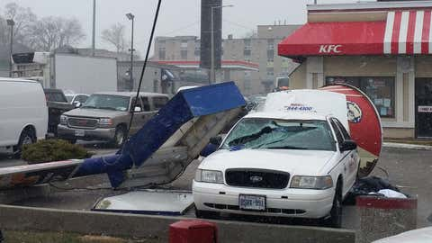 A KFC sign crashes into a parked car due to high winds in the King and Dundrun area of Hamilton. Photo courtesy of @StephenWelton/Twitter