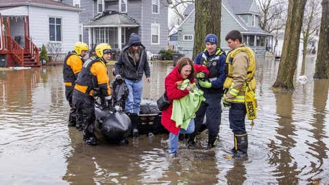 Emergency crews help evacuate residents Wednesday, Feb. 21, 2018, in Elkhart, Ind. Crews are using boats to help northern Indiana residents amid flooding from melting snow and heavy rain moving across the Midwest. (Becky Malewitz /South Bend Tribune via AP)
