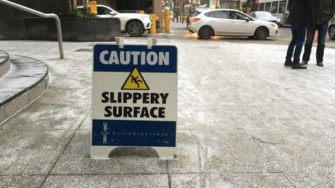 Slippery sidewalk and falling ice signs in downtown Calgary, February 2, 2018. (Photo Courtesy of 660 News Reporter Tahirih Foroozan)