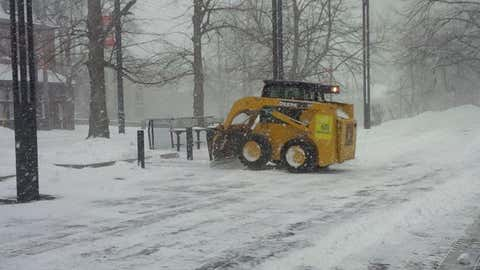 Snow removal crews outside the Halifax Central Library (Meghan Groff/HalifaxToday.ca)