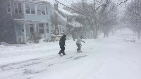 A man snowboards down a south end street on a snow day in Halifax. (Meghan Groff/HalifaxToday.ca)