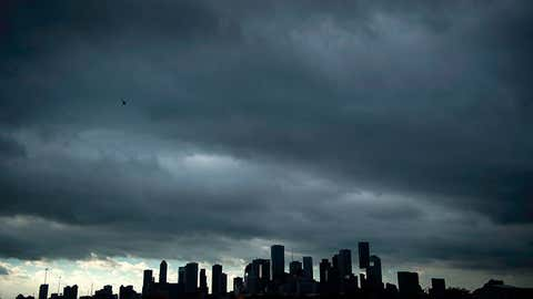 A view of the Houston skyline after heavy rains broke during the aftermath of Hurricane Harvey August 29, 2017. Harvey has set what forecasters believe is a new rainfall record for the continental US, officials said Tuesday. Harvey, swirling for the past few days off Texas and Louisiana has dumped more than 49 inches (124.5 centimeters) of rain on the region. (Brendan Smialowski/AFP/Getty Images)