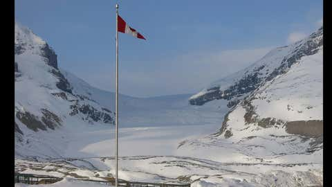 The Columbia Icefield, North America's most visited glacier, is shown in this photo taken May 5, 2015 from the Icefield Interpretive Centre. A Calgary man has survived a 30-metre fall into a glacier crevasse in the Columbia icefields area of Jasper National Park. Parks Canada says the 24-year-old was snowshowing with a friend Sunday on the Athabasca Glacier when he fell deep into the ice and was knocked unconscious. The pair were not wearing safety ropes or harnesses. (Bill Graveland/THE CANADIAN PRESS)