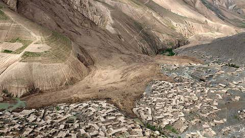 An aerial view shows the site of Friday's landslide that buried Abi Barik village in Badakhshan province, northeastern Afghanistan, Monday, May 5, 2014. Hundreds of people were killed in a horrific landslide and authorities are trying to help the 700 families displaced by the torrent of mud that swept through their village. The families left their homes due to the threat of more landslides, Minister for Rural Rehabilitation Wais Ahmad Barmak said. (Rahmat Gul/AP/CP)