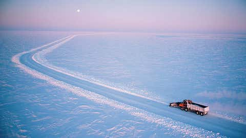 Snowplough in action widening road, high view across landscape in Northern Canada. (Provided by MacLean's)