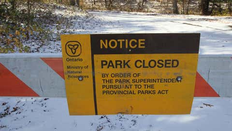 A sign posted at the Pinery Provincial Park is seen near Grand Bend, Ont. on Friday, Nov. 10, 2017. Ontario's Ministry of Natural Resources and Forestry says talks continue in an effort to resolve an issue that led to the closure of a provincial park nearly two weeks ago. (Dave Chidley/THE CANADIAN PRESS)