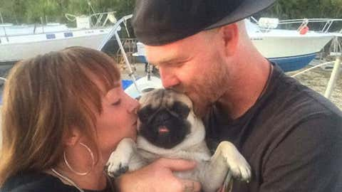 Tanner Broadwell and Nikki Walsh and their dog, Remy.
