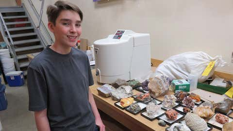 Teen geologist Judah Tyreman poses with rare rocks and minerals at the rock vault in geology building at the University of Saskatchewan in Saskatoon, Sask., in this recent handout photo. A teen geologist from the Saskatoon area is feeling a bit more weighed down after a visit to the rock vault at the University of Saskatchewan last week. But he's fine with that. Prof. Kevin Amstell invited 13-year-old Judah Tyreman to visit the geology building to help replenish some of the rare rocks and minerals that were stolen from the teen last month. (Chris Vandenbreekel/CKOM Radio – THE CANADIAN PRESS/HO)