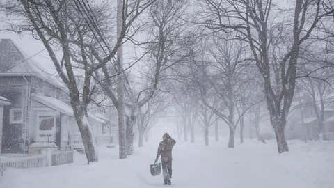 A man walks down the middle of Agricola Street in Halifax as a major winter storm blasts the Maritimes. (Darren Calabrese/THE CANADIAN PRESS)