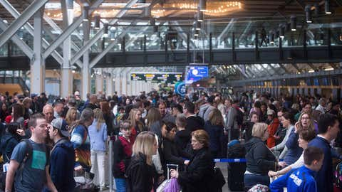 Hundreds of passengers wait in a lineup at Vancouver International Airport in Richmond, B.C., on Saturday April 1, 2017. Canadian holiday travellers should brace for crowds and delays as a record number of passengers are expected to pass through the country's largest airports and highways are filled with holiday travellers. (Darryl Dyck/THE CANADIAN PRESS)
