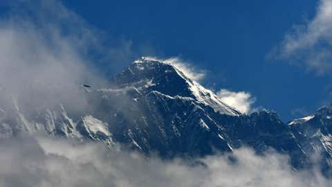 Mount Everest (height 8848 metres) is seen in the Everest region, some 140 km northeast of Kathmandu, on May 27, 2019. - Ten people have died in little more than two weeks after poor weather cut the climbing window, leaving mountaineers waiting in long queues to the summit, risking exhaustion and running out of oxygen. (Photo by PRAKASH MATHEMA / AFP)        (Photo credit should read PRAKASH MATHEMA/AFP/Getty Images)