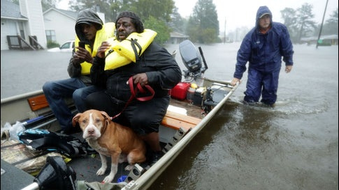 Volunteers help rescue residents and their pet from their flooded home during Hurricane Florence on September 14, 2018, in New Bern, North Carolina. Florence dumped the second greatest rains in U.S. history when measured by volume over a 14,000-square mile area.
