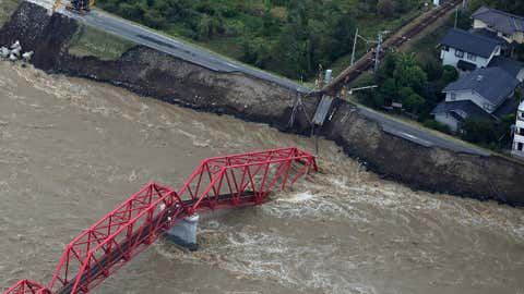 This aerial view shows a damaged train bridge over the swollen Chikuma river in the aftermath of Typhoon Hagibis in Ueda, Nagano prefecture on October 13, 2019. - At least 26 people were killed by powerful Typhoon Hagibis, local media reported on October 13, a day after the ferocious storm slammed into Japan, unleashing unprecedented rain and catastrophic flooding. (Photo by STR / JIJI PRESS / AFP) / Japan OUT (Photo by STR/JIJI PRESS/AFP via Getty Images)