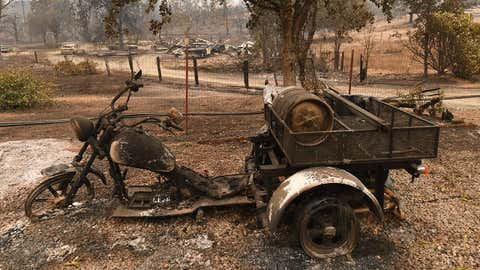 A burnt out motorcycle in the Keswick neighborhood of Redding, as the Carr fire continues to spreads towards the town of Douglas City near Redding, California on July 31, 2018. (MARK RALSTON/AFP/Getty Images)
