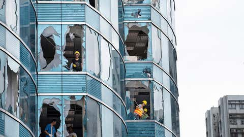 Super typhoon Mangkhut caused great damaged on a commercial building in Hong Kong. The super typhoon Mangkhut has passed next to Hong Kong on the 16th September causing large scale damages around the city, there are 432 people injured due to the storm with 2 still in critical condition. (Miguel Candela/SOPA Images/LightRocket via Getty Images)