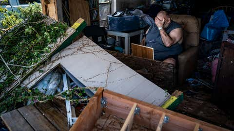Benny Hobson, 69, sits in his recliner on Thursday, Oct. 11, 2018 in Panama City, Fla., after loosing the front wall of his house after Category 4 Hurricane Michael made land fall along the Florida panhandle Wednesday.  Hobson rode the storm at his home with his wife and three dogs. (Jabin Botsford/The Washington Post via Getty Images)
