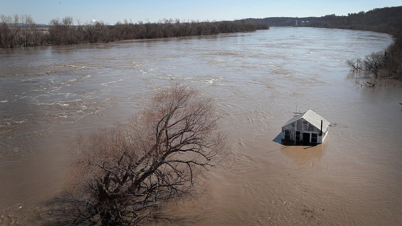 """A structure is surrounded by floodwater on March 21, 2019, in Atchison, Kan. Several Midwest states are battling some of the worst flooding they have experienced in decades as rain and snow melt from the recent """"bomb cyclone"""" has inundated rivers and streams. At least three deaths have been linked to the flooding. (Scott Olson/Getty Images)"""