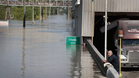 A driver looks over a floodwall as floodwater from the Mississippi River rises while he waits for his truck to be loaded with flour at Ardent Mills on May 30, 2019, in Chester, Ill. The middle-section of the country has been experiencing major flooding since mid-March especially along the Missouri, Arkansas and Mississippi Rivers. Towns along the Mississippi River have been experiencing the longest stretch of major flooding from the river in nearly a century.   (Scott Olson/Getty Images)