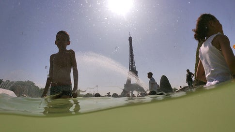 People cool off at the Trocadero Fountains next to the Eiffel Tower in Paris, on July 25, 2019, as a new heat wave hits Europe. After all-time temperature records were smashed in Belgium, Germany and the Netherlands on July 24, Britain and the French capital Paris could on July 25 to see their highest ever temperatures. (Dominique Faget/AFP/Getty Images)