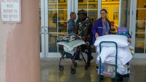 With the evacuation of St. Lucie County, Fla. lifted, residents who have been staying in the shelter at Fort Pierce High School leave to return to their homes on Sept. 4, 2019. (Adam DelGiudiceAFP/Getty Images)