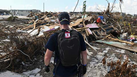 A Canadian search and rescue team search the debris in Marsh Harbour, Bahamas, on Sept. 10, 2019, one week after Hurricane Dorian. (Andrew Caballero-Reynolds/AFP/Getty Images)