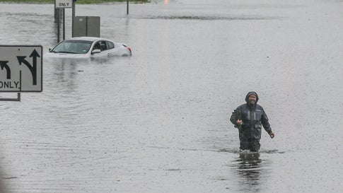 A man walks through the flooded feeder roads off of highway 69 North on Sept. 19, 2019, in Houston, Texas.  Gov. Greg Abbott has declared much of Southeast Texas disaster areas after heavy rain and flooding from the remnants of Tropical Depression Imelda dumped more than two feet of water across some areas. (Thomas B. Shea/Getty Images)