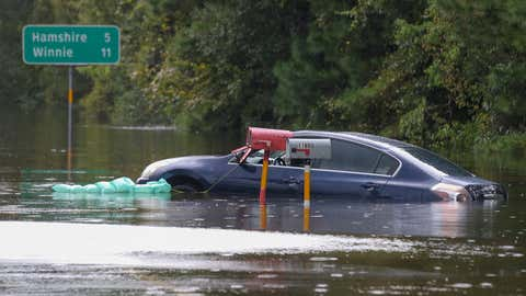 A car sits in the flooded waters on highway 124 on Sept. 20, 2019, in Beaumont, Texas. Gov. Greg Abbott has declared much of Southeast Texas disaster areas after heavy rain and flooding from the remnants of Tropical Depression Imelda dumped more than two feet of water across some areas. (Thomas B. Shea/Getty Images)