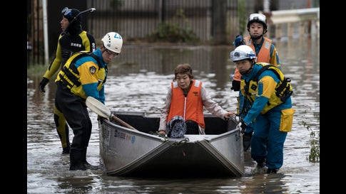 A woman is rescued by police officers in an area that was flooded by Typhoon Hagibis on Oct. 14, 2019 in Marumori, Miyagi, Japan. Japan has mobilized 110,000 rescuer workers after Typhoon Hagibis, the most powerful storm in decades, swept across the country leaving 55 dead and around 16 missing.  (Tomohiro Ohsumi/Getty Images)