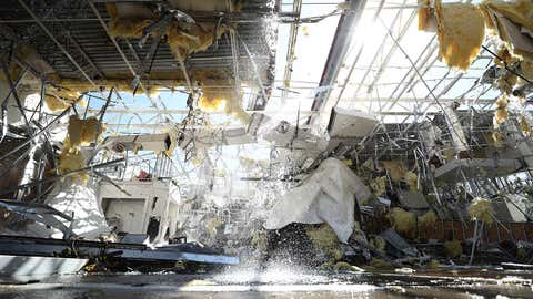 Water runs from a sprinkler system in a damaged Talbot's store on Oct. 21, 2019, in Dallas, Texas. A tornado struck Sunday night causing major damage to homes, businesses and schools but no deaths or serious injuries have been reported. (Ronald Martinez/Getty Images)