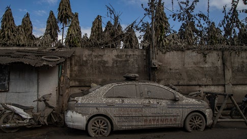 A police car is seen covered in volcanic ash from Taal Volcano's eruption on Jan. 14, 2020 in Talisay, Batangas province, Philippines. The Philippine Institute of Volcanology and Seismology raised the alert level to four out of five, warning that a hazardous eruption could take place anytime, as authorities have evacuated tens of thousands of people from the area. An estimated $10 million worth of crops and livestock have been damaged by the on-going eruption, according to the country's agriculture department. (Ezra Acayan/Getty Images)