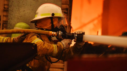 Rural Fire Service firefighters extinguish a fire on a property on Jan. 23, 2020, in Moruya, Australia. Temperatures are expected to reach 104 degrees Fahrenheit in Sydney and a total fire ban is in place across a number of regions including the Shoalhaven, Hunter, Illawarra, Sydney and the southern and central ranges due to the forecast hot and windy conditions. (Sam Mooy/Getty Images)