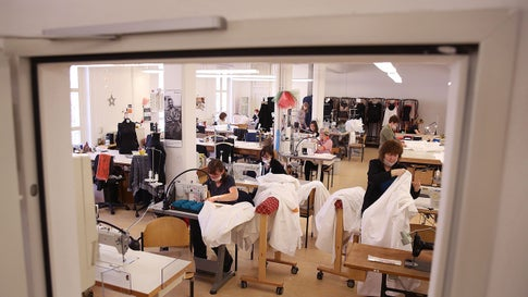 Staff members sew face masks and protective suits at the Ladies' Costume Workroom of the Schauspiel Leipzig theatre and opera house on March 27, 2020 in Leipzig, eastern Germany, to protect against the novel coronavirus. Face masks, suddenly in short supply, are first produced for the personal need of the theatre's staff, and maybe for other purposes too, afterwards. (Ronny Hartmann/AFP via Getty Images)