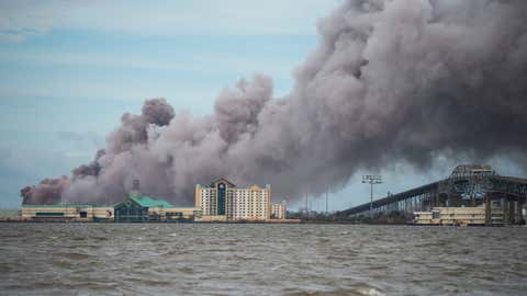 Smoke rises from a burning chemical plant after the passing of Hurricane Laura in Lake Charles, La., on Aug. 27, 2020. (Andrew Caballero-Reynolds/AFP via Getty Images)