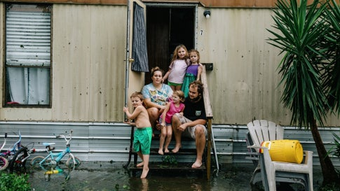 Clinton and Randal Ream, with their son Saylor and daughter Nayvie, and two neighbors Aubrey Miller and Harmony Morgan, at their home in a small trailer park in West Pensacola, Fla. The area received a lot of damage after Hurricane Sally came through as a Category 2 hurricane in Pensacola, Fla., on Sept. 16, 2020. (Bryan Tarnowski for The Washington Post via Getty Images)