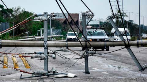 View of fallen power lines after the passage of Hurricane Zeta, in Puerto Morelos, Quintana Roo state, Mexico, on Oct. 27, 2020. Zeta was downgraded to a tropical storm on Tuesday after making a landfall on Monday night as a Category 1 hurricane near the resort of Tulum, in the Mexican Caribbean, hit recently by cyclone Delta. (Elizabeth Ruiz/AFP via Getty Images)